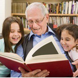 grandfather-grandchildren-reading-book-260nw-45340903